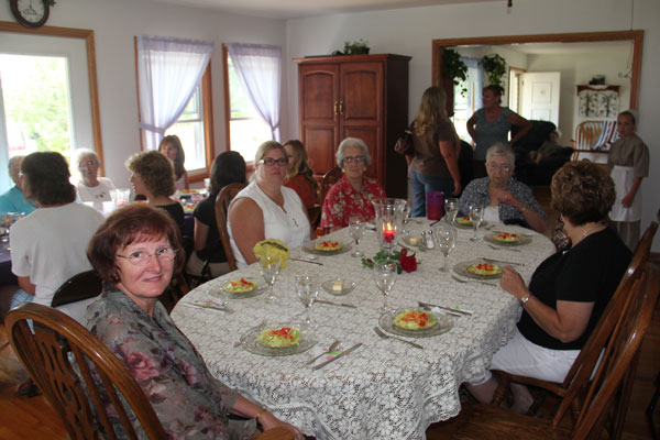 Wanda having dinner in an Amish home, following her book signing at Rockome Gardens in Arcola, IL.