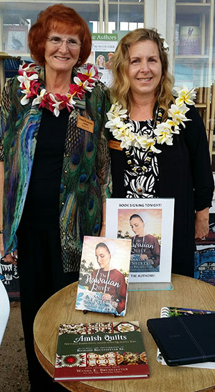 Wanda signing books in Kauai, Hawaii with co-author, Jean.