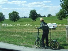Amish boy on a scooter