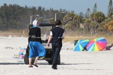Amish couple walking on the beach