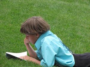 Amish child reading Wanda's children's book