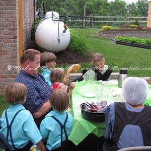 Making balloon animals for Amish children