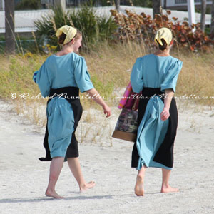 Amish girls walking on the beach
