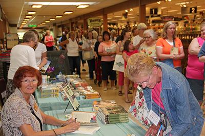 Wanda signing books in Shipshewana, Indiana.